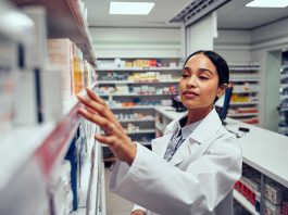 Young woman working in a compounding pharmacy in Melbourne